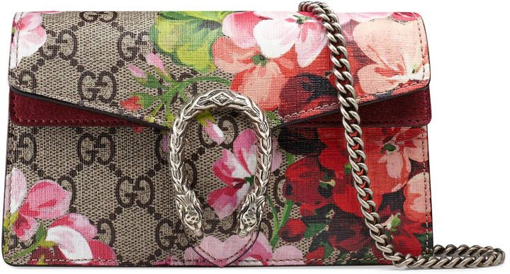 5954d5eb9869 Creative Carryall  Classic Gucci print meets floral art in this Dionysus GG  Blooms super mini bag. A structured Blooms GG Supreme canvas chain super  mini ...