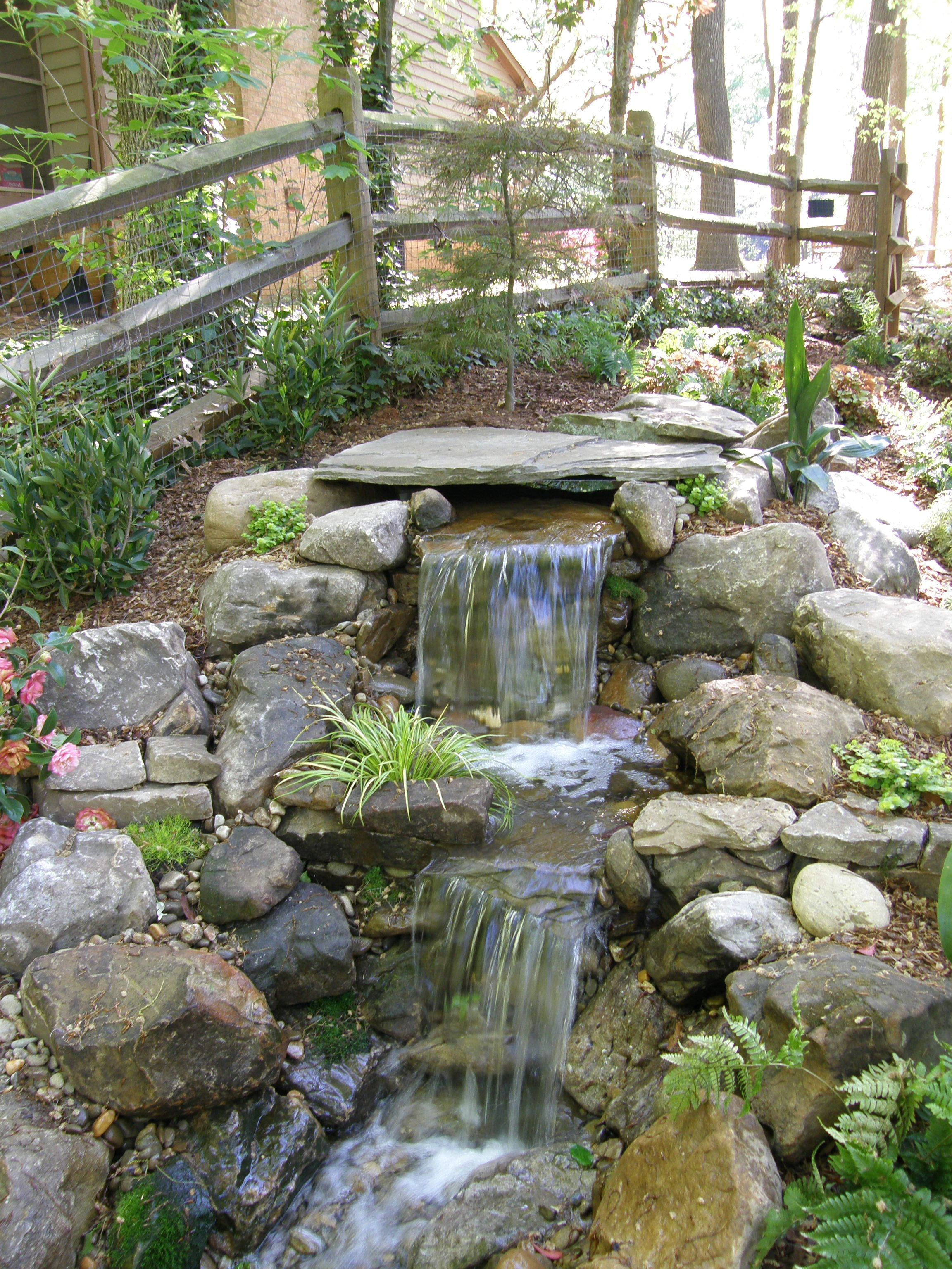 Ponds and waterfalls pondless waterfalls pond for Waterfall garden feature