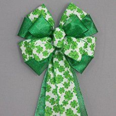 Make these quick, easy and inexpensive St. Patrick's Day garland and wreath crafts, created using all dollar store supplies.