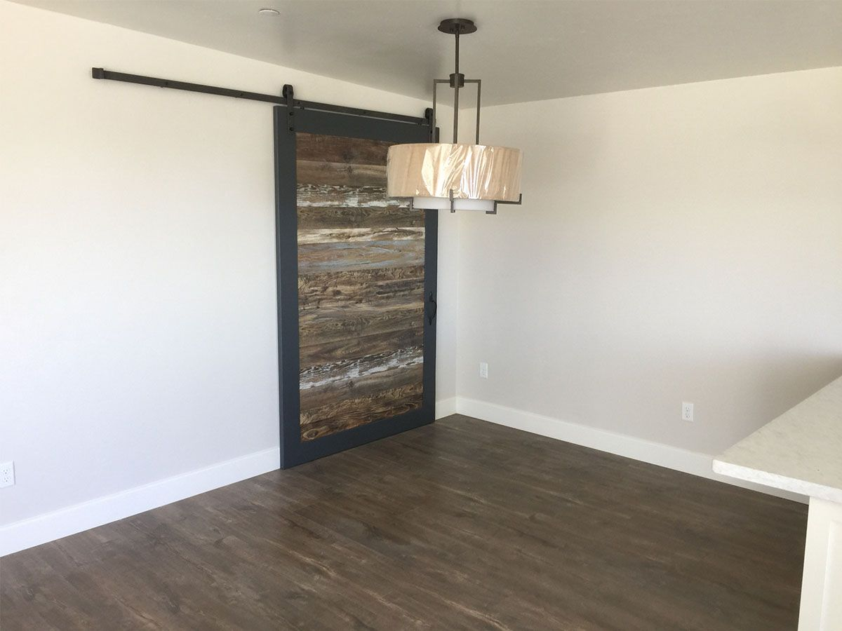 Quick-Step Reclaime Mocha Oak and reclaimed barndoor in a