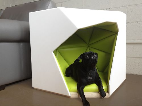 The Geodog by Laser Lab Studios is a modern indoor dog house and side table combo featuring a geometric design and a unique blend of materials.