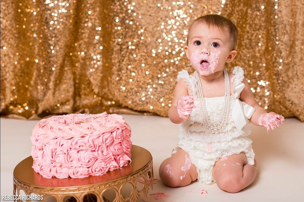 Sequin backdrops are perfect for cake smashes! Photo by Rebecca Richards Photography