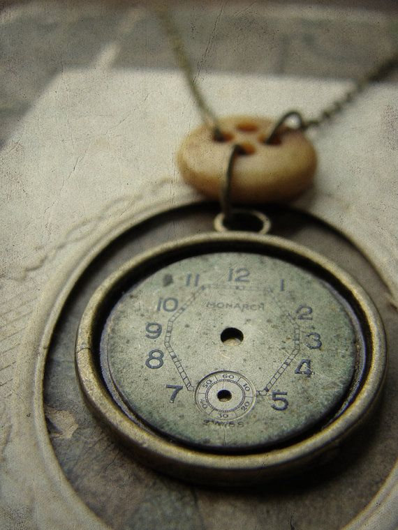 Antique repurposed watchface and civil war era bone button necklace by Luminoddities on Etsy.com $36