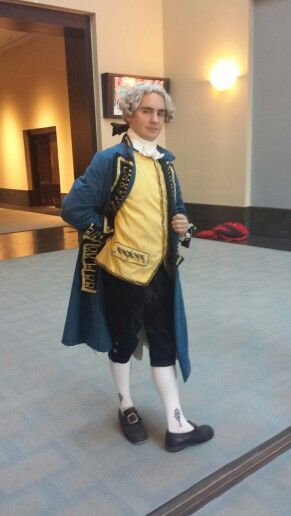 1770s upper class gentleman. Blue velvet coat and breeches with embroidered yellow silk waistcoat.
