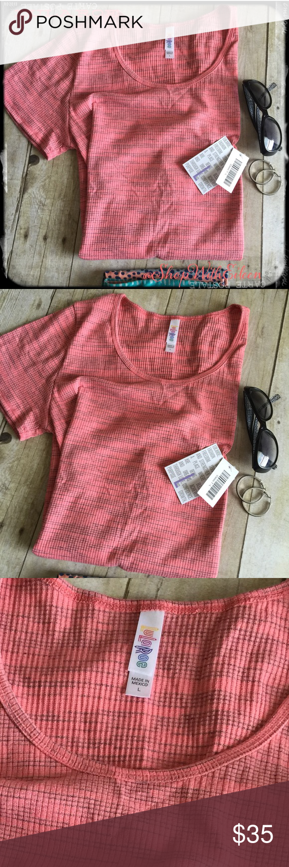 """🆕 Lularoe CORAL HEATHERED RIBBED Classic T~ 🆕 Lularoe CORAL HEATHERED RIBBED Classic T~ The """"Classic T"""" is sure to become a wardrobe staple. The Classic T is made from comfortable spun polyester jersey and is short sleeved with a high round neck line. This classic t is ribbed but not that stretchy ribbing! Material is 57% Cotton 41% Polyester & 2% Spandex! * This is not the ribbed fabric that stretches out losing its shape!  * I am not a consultant… Just a Lularoe addict that likes to…"""