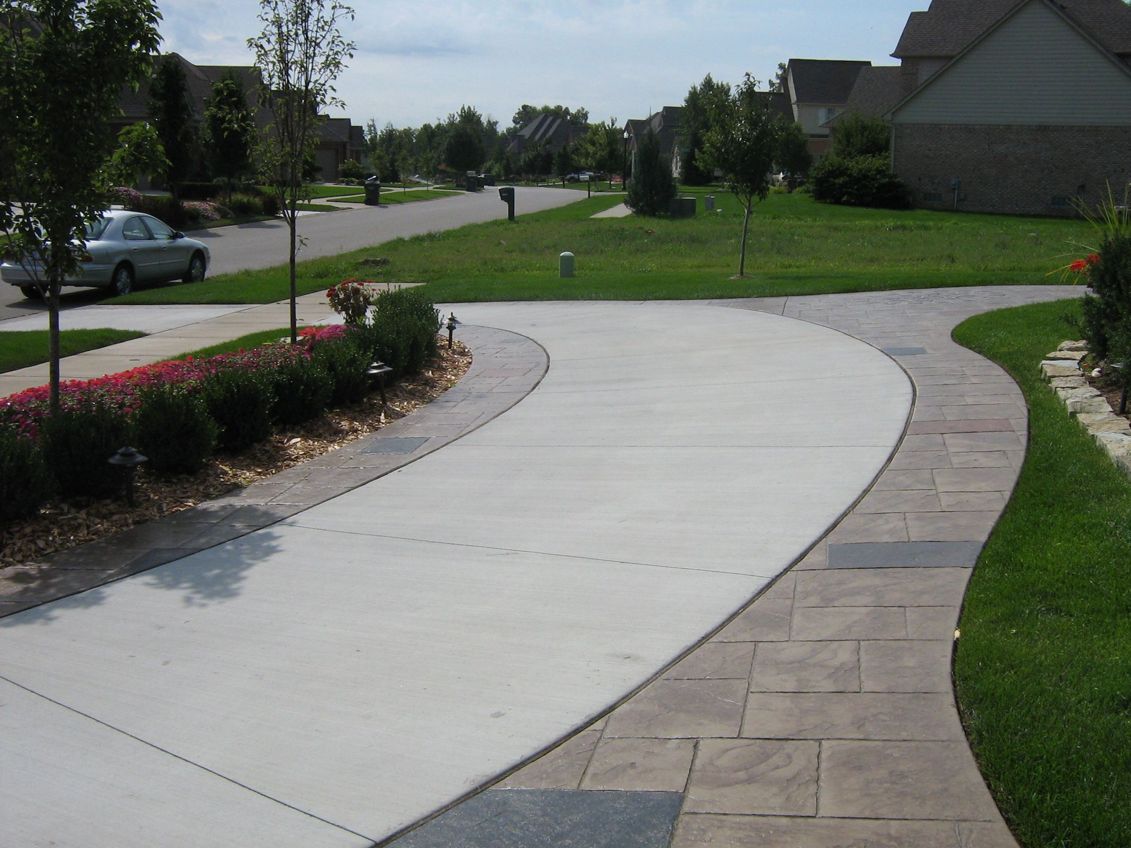 Cg front blocks edging our solid driveway curving for Cement driveway ideas