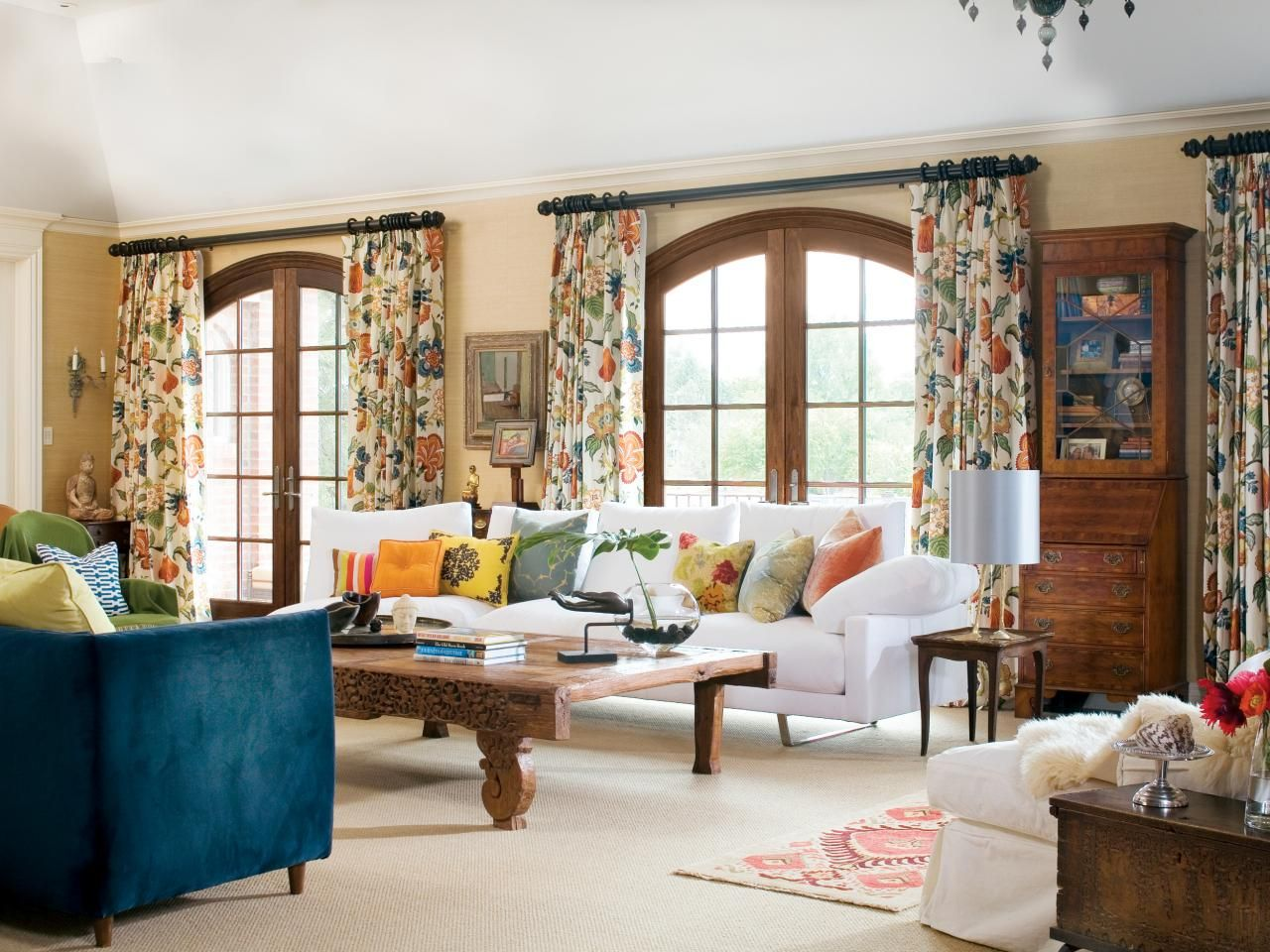 These patterned floral drapes pull accents from all over for Living room door designs