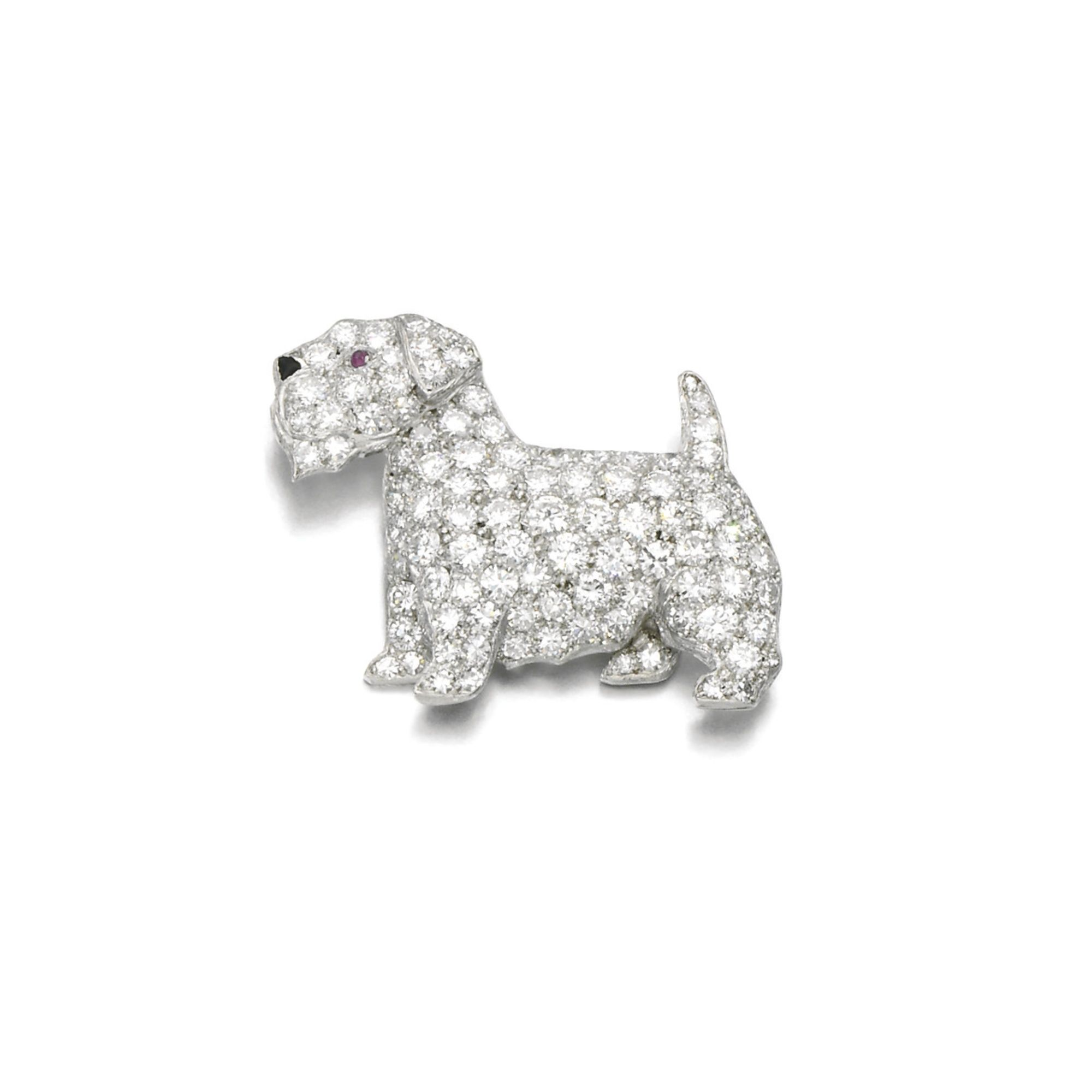 Diamond, ruby and onyx brooch, Cartier, 1930s Designed as a Norfolk Terrier, pavé-set with circular- and single-cut diamonds, with cabochon onyx nose and ruby eye, signed Cartier, numbered.