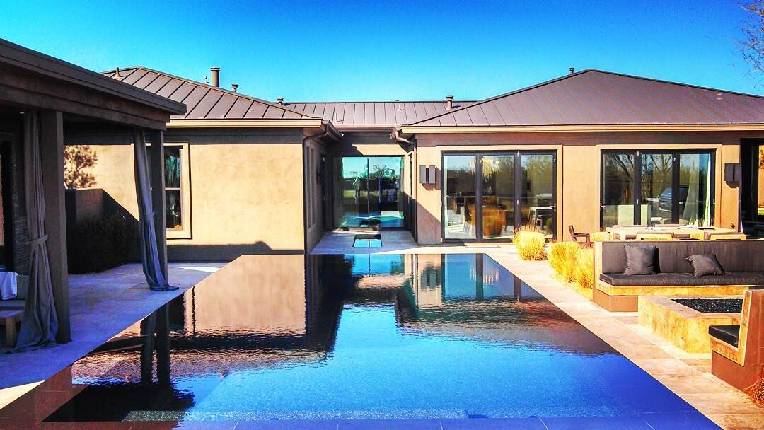 Reflections in the mid century modern elevated glass pool. #pool #swimmingpool #swim #black #az #design #modern #midcentury #midcenturymodern #luxury #luxurylife #glass #tile #designer #unique #backyard #scottsdale #furniture #houzz #homedecor