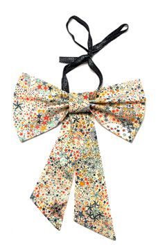 Bow necklace for your little one.