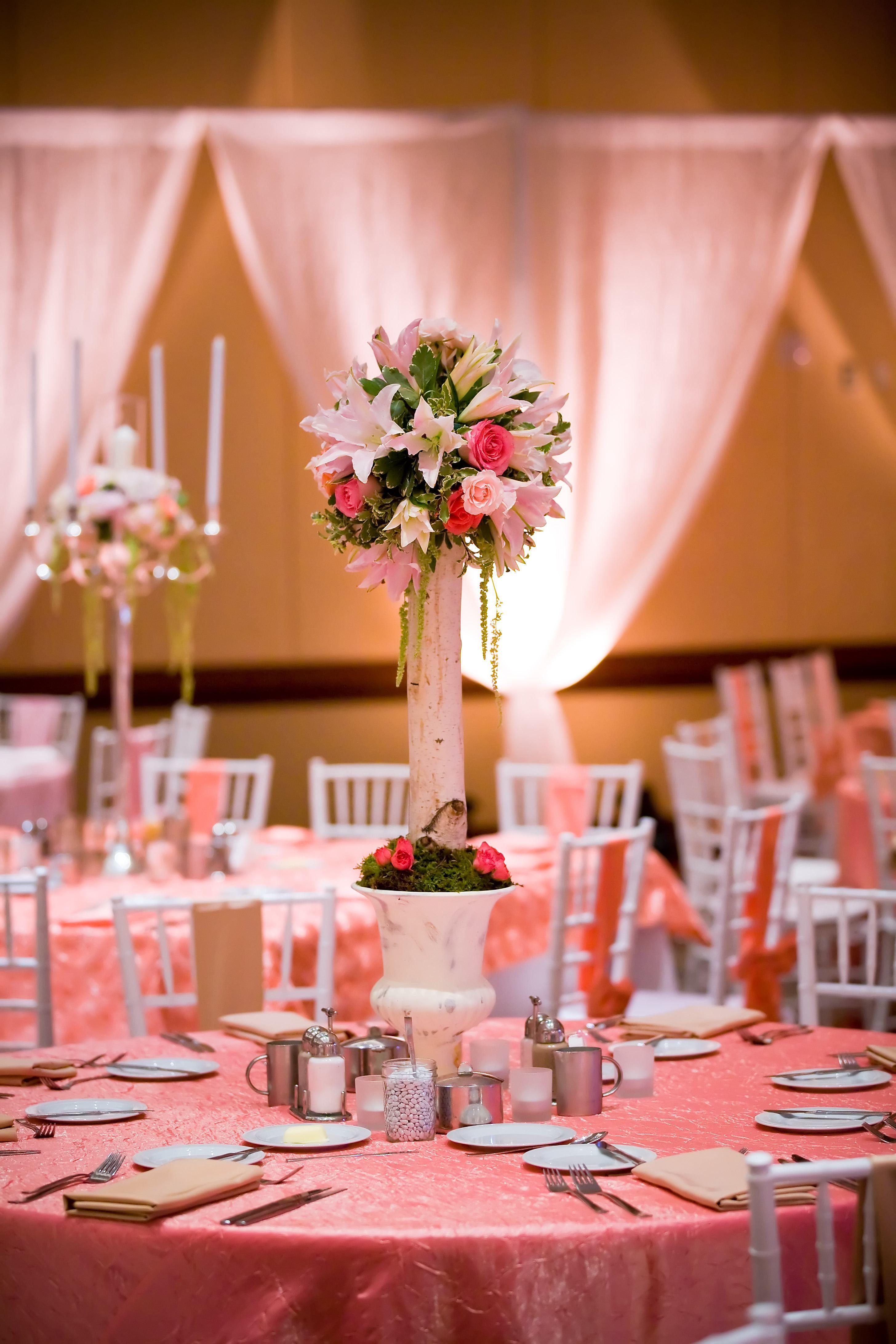 White draping, uplighting, floral centerpiece, mitzvah