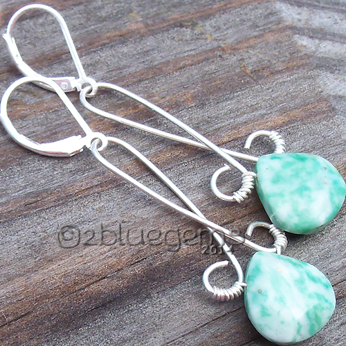 """Beautiful green and white Ching Hai jade faceted briolettes are wrapped in fine silver and silver filled wire and hung on silver-filled lever ear wires.  Earrings hang just over 2"""" from the top of the wire to the bottom of the briolette."""