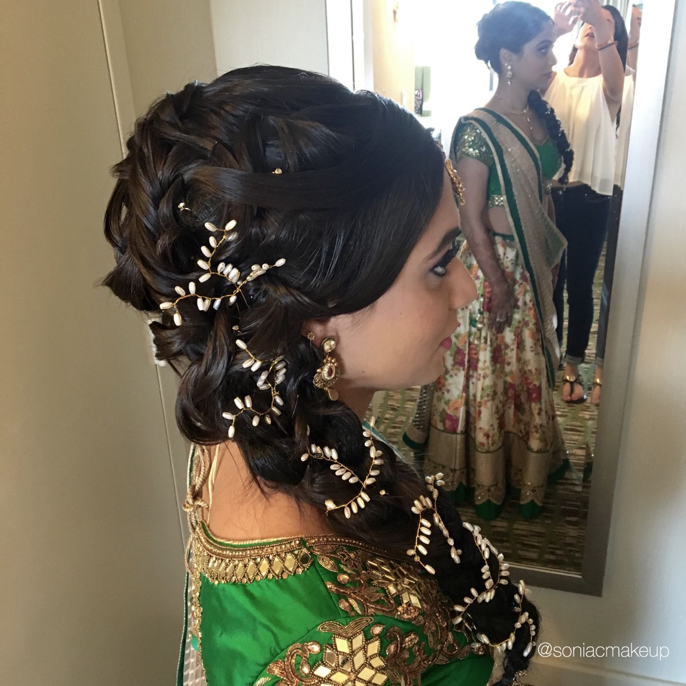 braided hair with pearl pins, braided updo, indian wedding