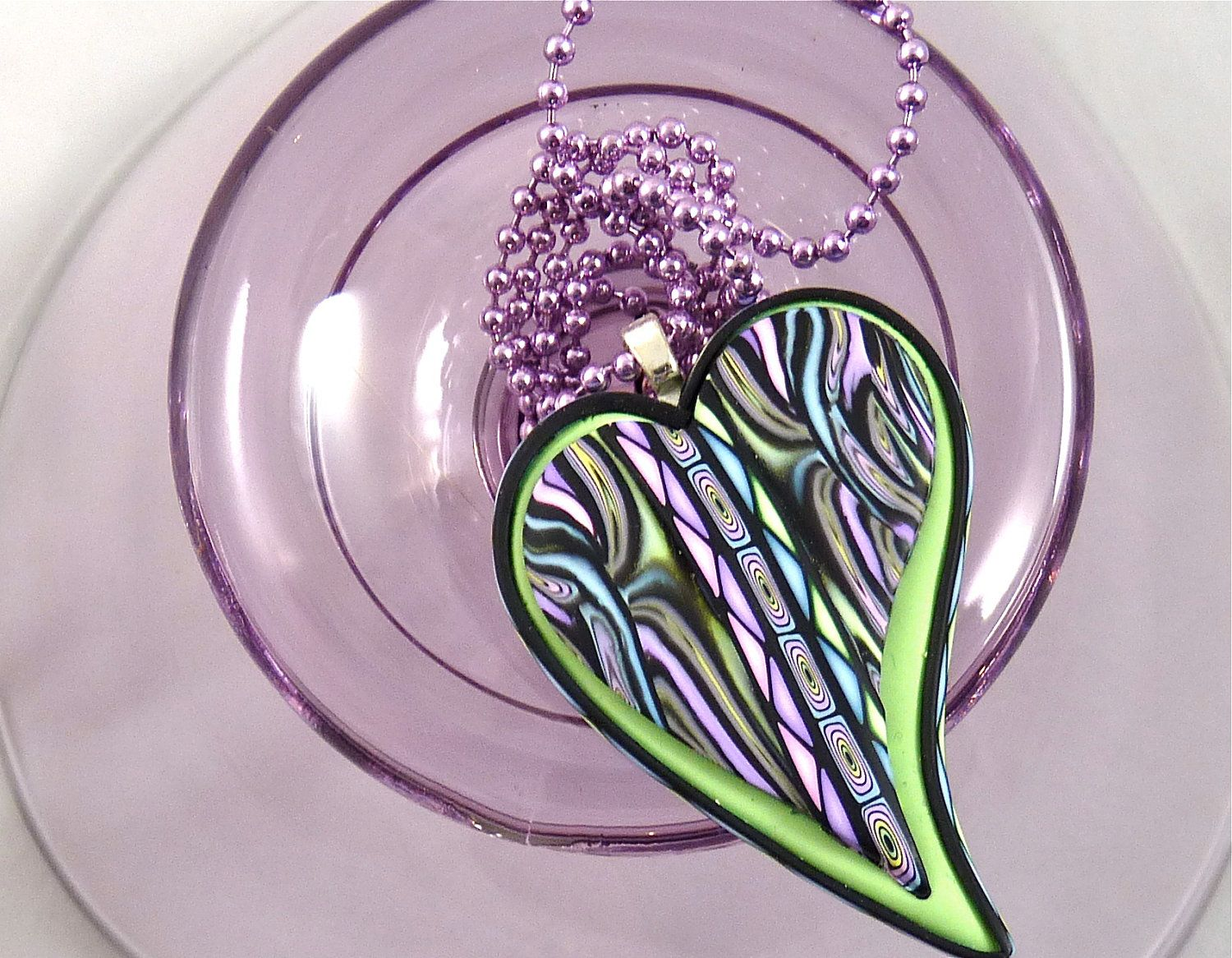 Polymer Cay Heart Pendant with Lime Green and Multi-Color Border Cane with Black Details. $24.00, via Etsy.