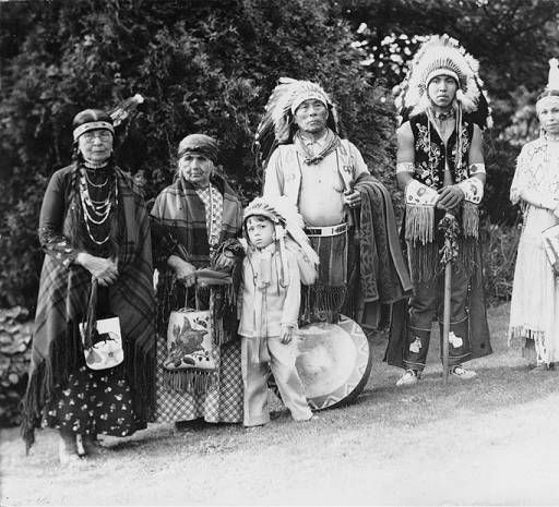 Tulalip family in ceremonial dress pose in Volunteer Park, Seattle, Washington, 1938 :: American Indians of the Pacific Northwest