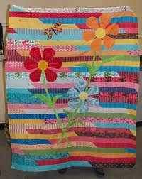 Jelly Roll Race Quilt With Applique - What a nice addition to make it more special!