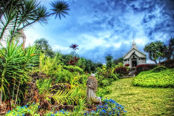 Overlooking beautiful and historic Kealakekua Bay, St. Benedict's Painted Church is a fascinating place to visit on your journey to the Big Island of Hawaii. Located in the famous Kona coffee growing region, it is the jewel of South Kona, at a place called Honaunau.