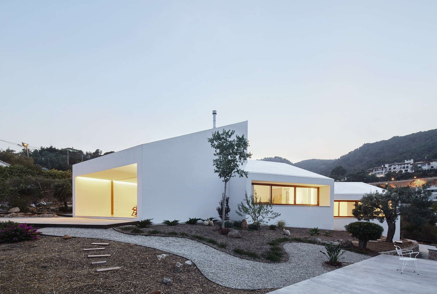 This house looks for the maximum energy efficiency adapting itself to the program, the solar orientation, the views and the slope of the terrain.  The projec...