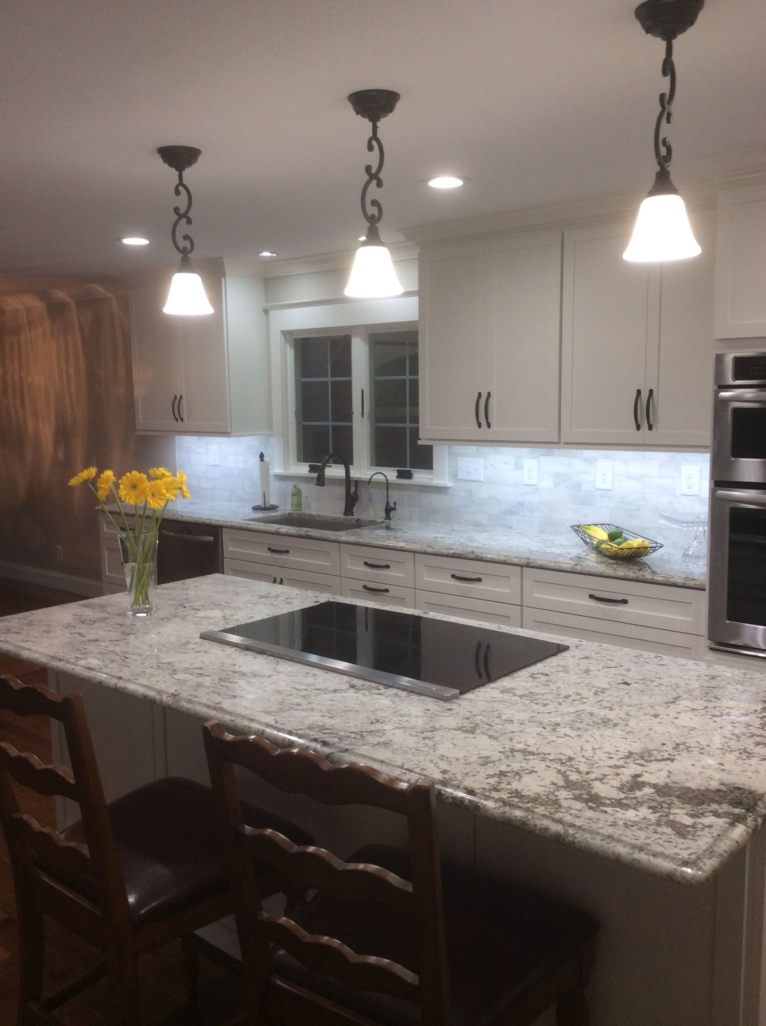 My new kitchen white shaker cabinets and white ice granite