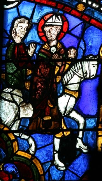 The Becket Window depicts the life and violent death (in 1170) of St. Thomas Becket, Bishop of Canterbury. Murdered by agents of the king as he kneeled in prayer in Canterbury Cathedral, the English saint became popular throughout Europe and well known in the diocese of Chartres. Canterbury has several medieval Becket Windows, which are interesting to compare to this one across the Channel. The window is located on the side of a radiating chapel in the south ambulatory.