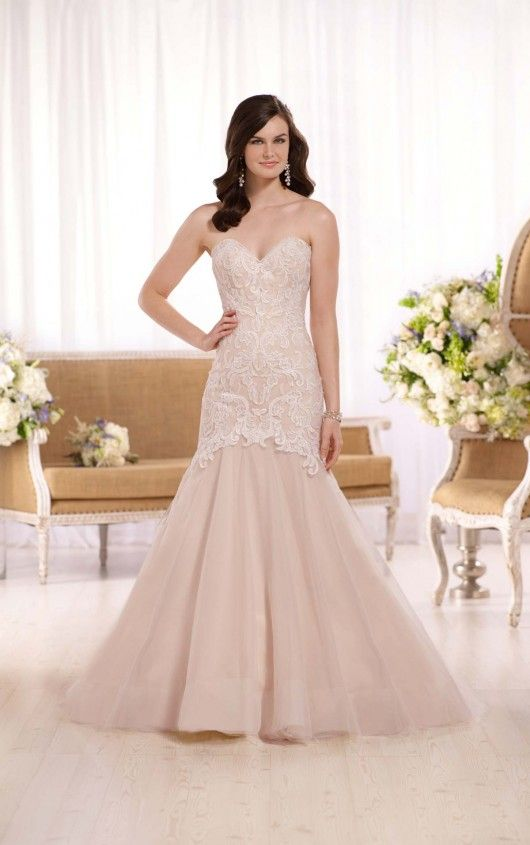 Feminine, yet modern, this lace and tulle fit-and-flare wedding gown ...