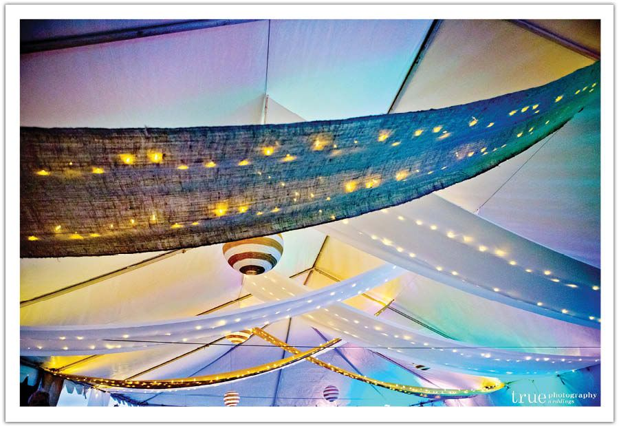 We draped burlap and string lighting, as well as striped lantern balls from the tent that sparkled after sunset.  Design by Alchemy Fine Events