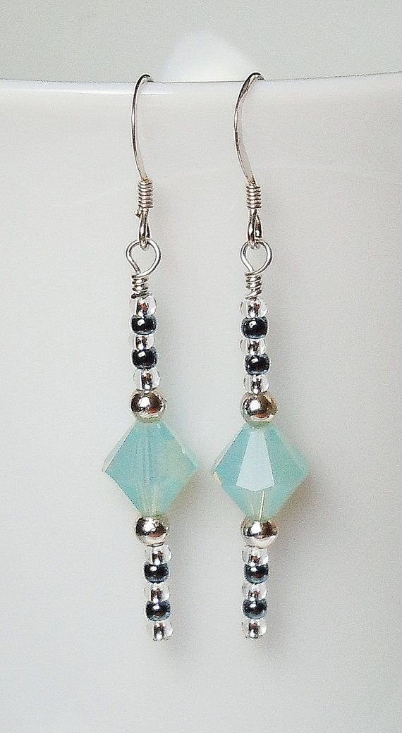Swarovski Pacific Opal and Silver Earrings is part of Jewelry making earrings, Homemade jewelry, Beaded jewelry, Fine jewelry, Jewelry design, How to make earrings - Earrings made of Swarovski crystal bicones in gorgeous Pacific Opal and gray and clear glass seed beads  Really fun earring that work for everyday casual wear or to accent a beautiful dress   If you'd like this style with different colors, please convo me for availability  We stock most Swarovski colors   The French ear wires are sterling silver   These earrings hang approximately 1 5  in length   Classic earrings like this make a great gift!  Custom orders for different colors and sizes are available  Convo me with specific requests or questions  Gift Box Available