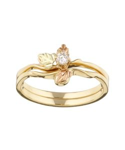 this beautiful wedding set is made of black hills gold featuring a yellow gold band and green and pink leaves for a unique look shes sure to love the ring - Black Hills Gold Wedding Rings