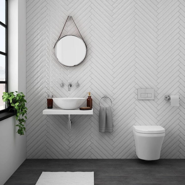 Looking For A Longer Than Usual Wall Tile Our Station White Gloss Herringbone Wall Tiles 6 5x40cm Are Th In 2020 Wall Hung Toilet Herringbone Wall Tile Small Bathroom