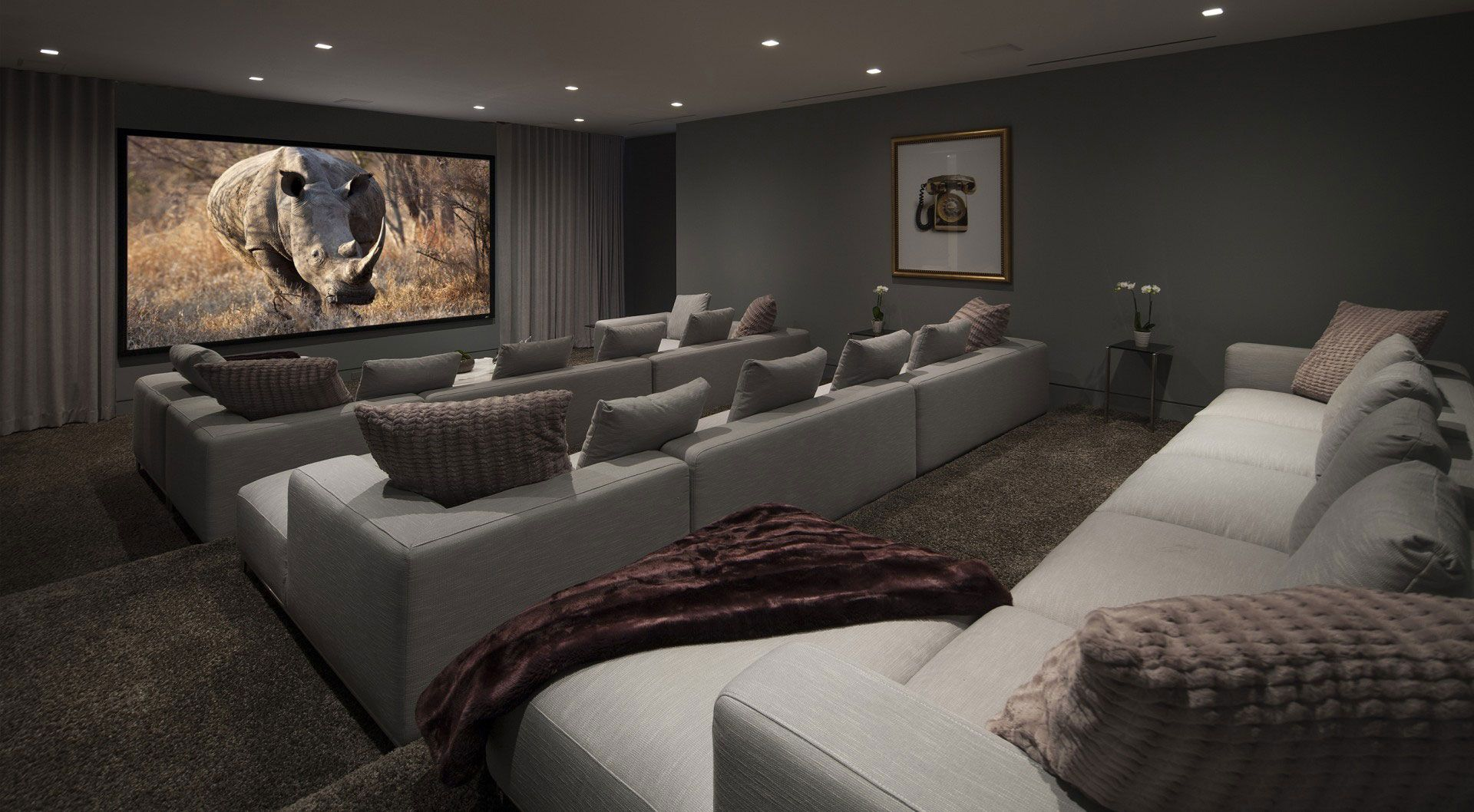 Living Room Grey Fabric Seats Connected By Large Lcd Tv On Grey Wall And Som