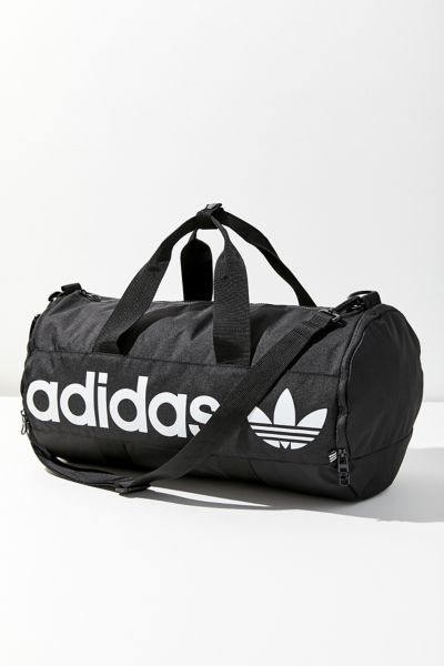 dbdae001a7 Shop adidas Originals Paneled Roll Duffel Bag at Urban Outfitters today.  Discover more selections just like this online or in-store. Shop your  favorite ...