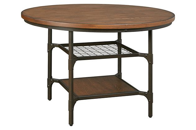 Rustic wood finish paired with weatherworn-style metal offers a dual serving of vintage charm that's as fresh as ever. Rolena dining room table's round top makes for great flow and a friendly, inviting feel.
