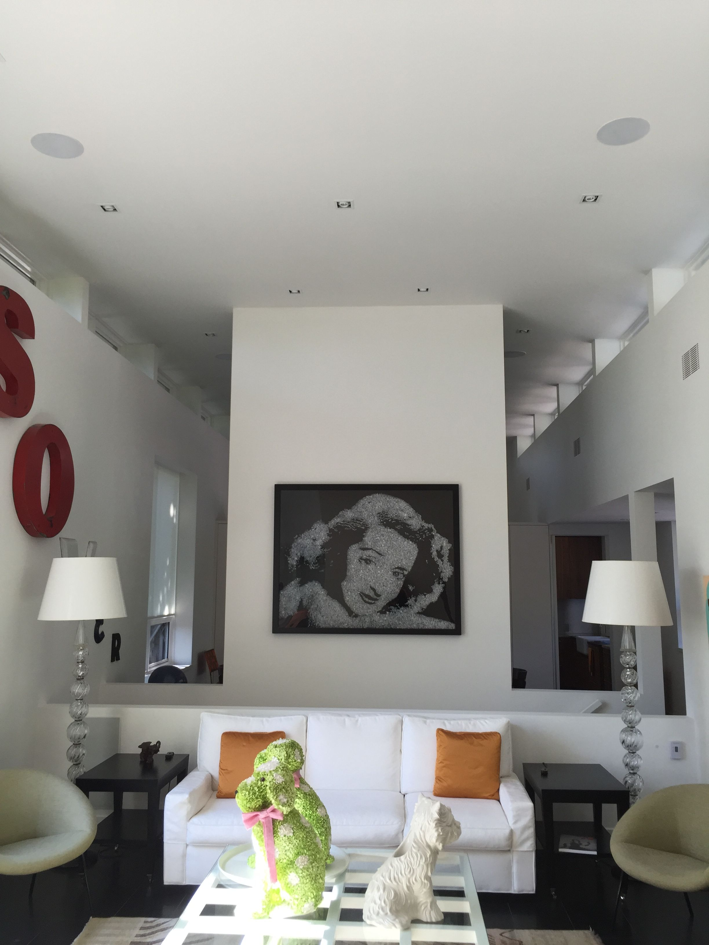Large Living Room With In Ceiling Speakers And An In Wall