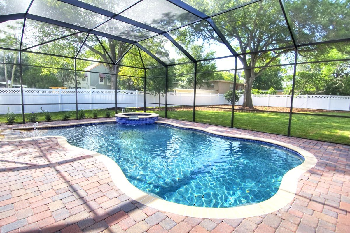 20x40 Pool Screen Enclosure Installed In Residential Backyard Over Paver Patio Pool Houses Pool Patio Backyard Pool