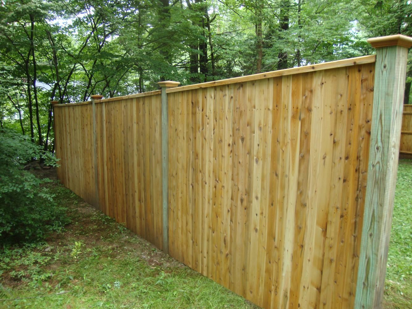 6 High Traditional Cedar Board Fence With Pressure Treated Posts And Colonial Caps Cedar Boards Fence Panels Modern Design
