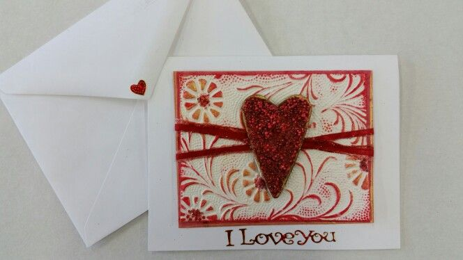Made with our beautiful embossed paper, a Prills covered heart and Great Tape.