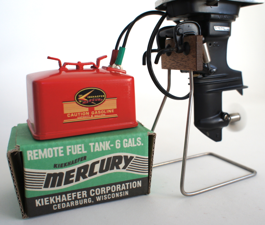Toy outboard motor gas tank battery (flat pin) with oval Mercury logo - www