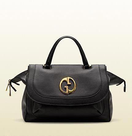 34199f7f5b0 Just love this classic purse. Gucci 1973 black leather top handle bag. Black  leather