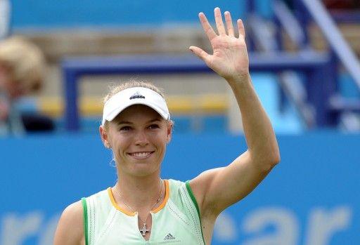 テニス、エイゴン国際(AEGON International 2014)女子シングルス2回戦。勝利を喜ぶカロリーネ・ボズニアツキ(Caroline Wozniacki、2014年6月18日撮影)。(c)AFP=時事/AFPBB News