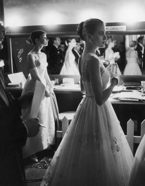 Audrey Hepburn and Grace Kelly backstage at the 28th Annual Academy Awards in 1956