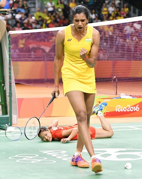 Pv Sindhu Of India Reacts As Japan S Nozomi Okuhara Watches While Lying On The Tennis Players Female Women S Badminton Badminton