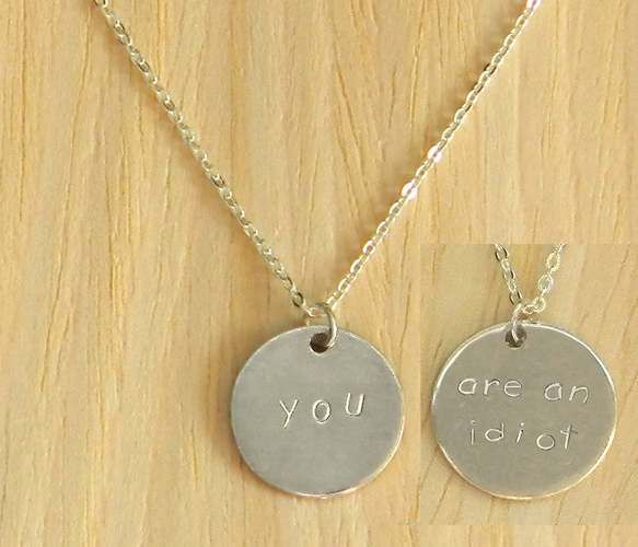 "Two Sided Charm Necklaces -""you.....are an idiot"". Hahahaha"