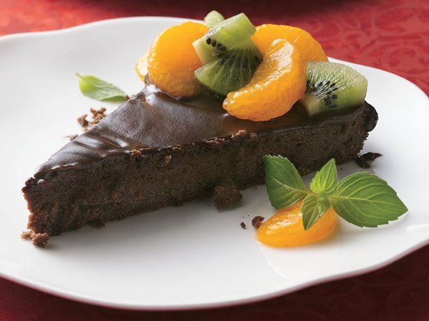 Kiwi and mandarin oranges add a juicy burst of freshness to a rich, tempting tart.