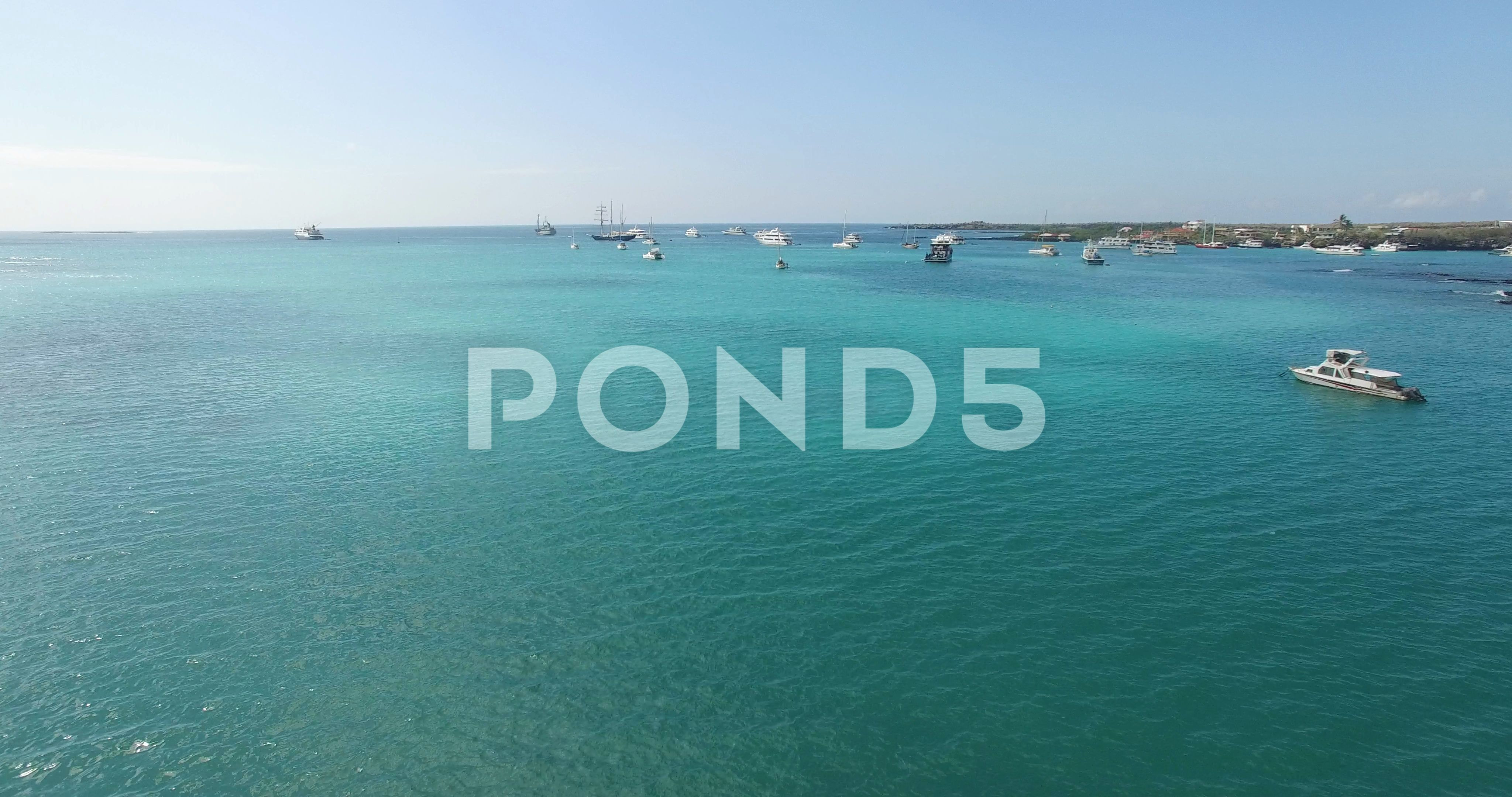 Overhead Drone Aerial Shot Of Tropical Ocean With Boats Puerto Ayora Galapagos Stock Footage Shot Tropical Ocean Overhead Aerial Overhead Ocean