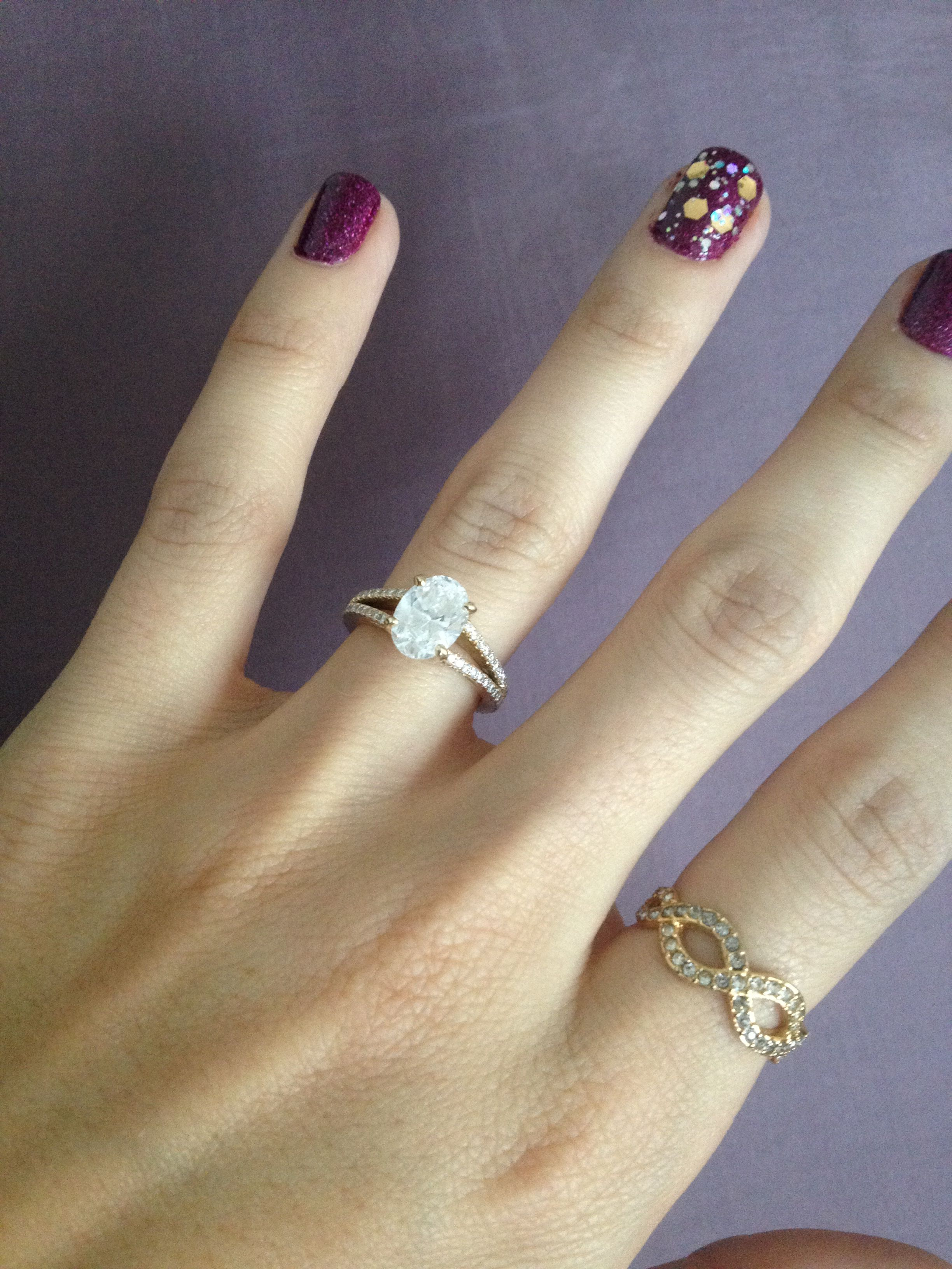 Yellow gold oval engagement ring with split shank