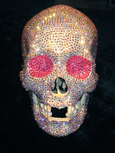 Swarovski crystallized female rainbow human skull.