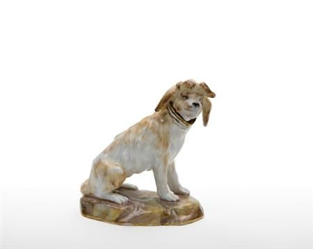 Meissen Porcelain Scent Bottle and Stopper  19th Century  Modeled as a terrier seated on a rocky mound,
