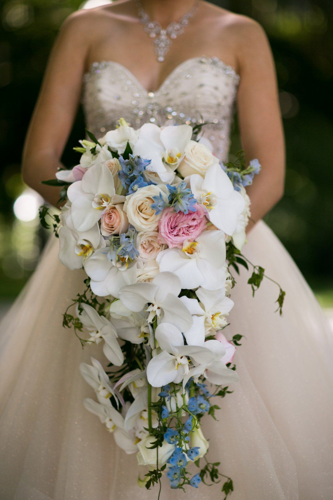 Long cascading white orchid bouquet for a disneyland bride floral long cascading white orchid bouquet for a disneyland bride mightylinksfo
