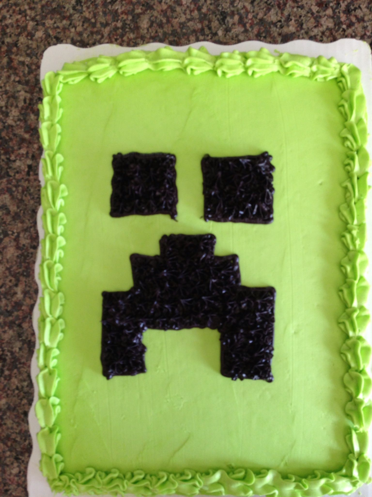 Ordered 1/2 sheet cake green & put the Creeper Face on myself. Not perfect but I've never decorated a cake before!