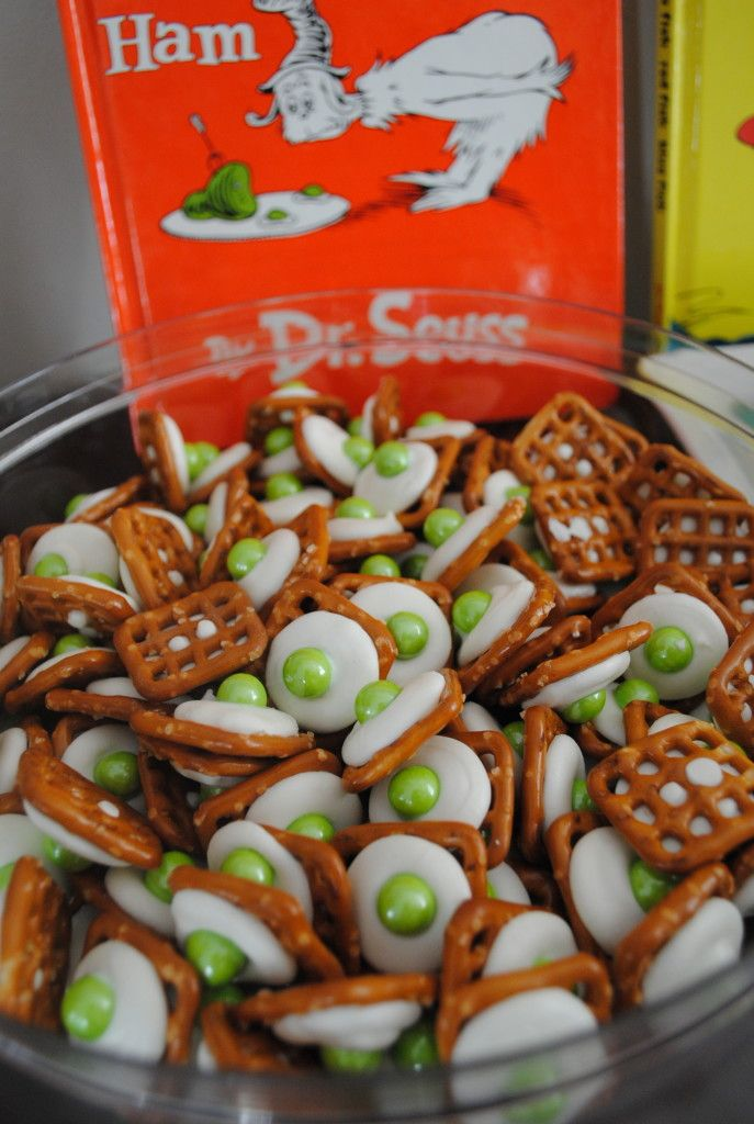 Cute Green Eggs and Ham for Dr. Seuss's birthday celebration. (On cookie sheet, place white candy melt on each pretzel. Bake at 350 for 2-3 min. Once out of the oven press green m&m)